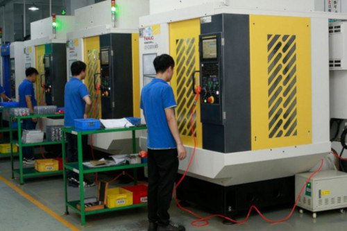 Experienced CNC operators using precision milling equipment